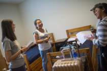 Cathy Wu, center, smiles inside her room inside the New Hall student residence while talking with Jordan Anderson, right, and Amanda Buchanan. ( AJ Reynolds/Brenau University)