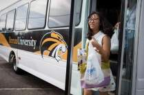 Lisa Wang walks off the bus with items she bought for her residence. (AJ Reynolds/Brenau University)