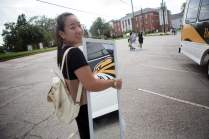 Cathy Wu holds a mirror she bought on her first shopping trip to Walmart. (AJ Reynolds/Brenau University)