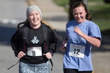 Sara Jane Bowers, left, and Brittany Brookins cross the finish line during the Dempsey Dash 5K, a race celebrating the memory of Brenau's longtime Executive Vice President and CFO Wayne Dempsey, on Saturday, March 11, 2017. (AJ Reynolds/Brenau University)