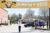 Wright Dempsey poses for a photo under the starting banner after the Dempsey Dash 5K, a race celebrating the memory of Brenau's longtime Executive Vice President and CFO Wayne Dempsey, on Saturday, March 11, 2017. (AJ Reynolds/Brenau University)