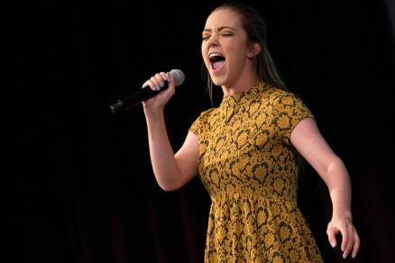 """Lauren Hill performs """"Defying Gravity"""" during the 4th Annual Women's Leadership Colloquium on Friday, March 17, 2017. (AJ Reynolds/Brenau University)"""