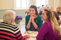Allie Smith and Hannah Vigil-Shuck, right, listen as Janis Wilson, a former home economics instructor at Brenau, speaks with them during the Back to Campus Luncheon. (AJ Reynolds/Brenau University)