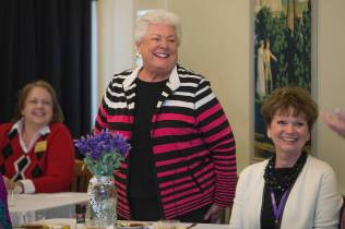 Janis Wilson, a former home economics instructor at Brenau, smiles while introducing herself to a group of alumnae at the Back to Campus Luncheon. (AJ Reynolds/Brenau University)