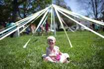 Emma Magness, 1, daughter of Sarah Magness, class '07, sits near the may day pole during the 2017 Alumnae Reunion Weekend at Brenau University, Saturday, April 08, 2017. (Photo/ John Roark for Brenau University)