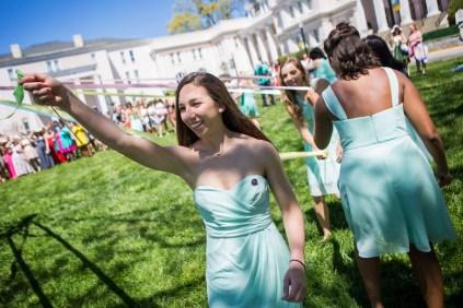 Lauren Sanders wraps her ribbon around the Maypole. (AJ Reynolds/Brenau University)