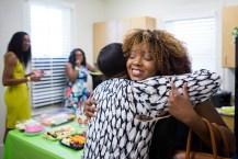 Anna-Marie Jordan, WC '16, gets a hug from another alumna at the Alpha Kappa Alpha Sorority, Inc. open house. (AJ Reynolds/Brenau University)