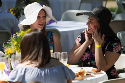 Nayhene Rosa WC '13, left, and Caylen Perry WC '15, reminisce during the Champagne Brunch. (AJ Reynolds/Brenau University)