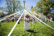 May Queen Sara Hubaishi stands under the May Pole. (AJ Reynolds/Brenau University)