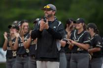 Brenau softball head coach Devon Thomas, center, and members of the Brenau softball team show their appreciation to the Ivesters during a pregame celebration. (AJ Reynolds/Brenau University)