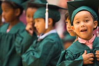 Josias Ordonez reacts before getting his diploma during the commencement ceremony for the RISE Program on Friday, July 14, 2017 at Fair Street School. (AJ Reynolds/Brenau University)
