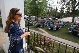 Ashley Carter, director of alumni and constituent engagement, reads off raffle winners during the homecoming celebrations at Brenau University. (AJ Reynolds/Brenau University)