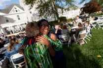 Darnisha Coverson, WC '12, gets a hug from Debbie Thompson at the Reunion on the Lawn. (AJ Reynolds/Brenau University)