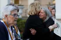 Julie McEver Kirksey, WC '68, gets a hug after being pinned. (AJ Reynolds/Brenau University)
