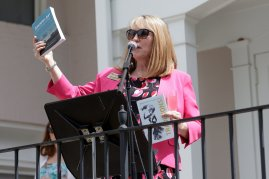 Debra Dobkins, dean of The Women's College, welcomes alumnae to the Champagne Brunch. (AJ Reynolds/Brenau University)
