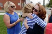 Rebecca Gates Page gets a hug at a Chi Omega reunion (AJ Reynolds/Brenau University)