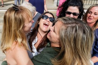 Academy alumnae laugh at the Academy 90th anniversary celebration. (AJ Reynolds/Brenau University)