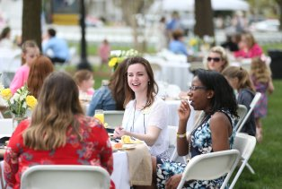 Brooke Bargeron Statham listens to Brenau President Ed Schrader speak during the Champagne Brunch and Silent Auction of the Alumnae Reunion Weekend & May Day at Brenau University Saturday, April 14, 2018, in Gainesville, Ga. Photo by Jason Getz / Brenau University