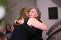 Dean of Fine Arts and Humanities Andrea Birch, right, hugs Professor of Interior Design Lynn Jones during the Interior Design Retrospective at the Burd Center for the Performing Arts at Brenau University Saturday, April 14, 2018, in Gainesville, Ga. Photo by Jason Getz / Brenau University