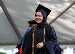 Razia Hussaini reacts before she received her diploma during the Women's College Commencement at Brenau University Friday May 4, 2018 in Gainesville, Ga. (Jason Getz for Brenau University)