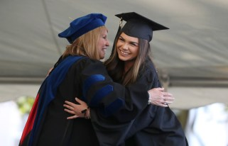 Kari Twyman hugs the dean of the women's college Debra Dobkins during the Women's College Commencement at Brenau University Friday May 4, 2018 in Gainesville, Ga. (Jason Getz for Brenau University)