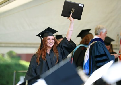 Lauren Gaddis reacts after she received her diploma during the Women's College Commencement at Brenau University Friday May 4, 2018 in Gainesville, Ga. (Jason Getz for Brenau University)