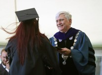 Brenau University President Ed Schrader gives a diploma to a graduate during the Women's College Commencement at Brenau University Friday May 4, 2018 in Gainesville, Ga. (Jason Getz for Brenau University)