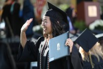 Jane Lim waves to her family after she received her diploma during the Women's College Commencement at Brenau University Friday May 4, 2018 in Gainesville, Ga. (Jason Getz for Brenau University)