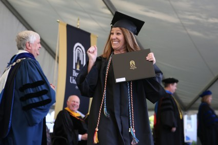 Jessica Thomas reacts after she received her diploma during the Women's College Commencement at Brenau University Friday May 4, 2018 in Gainesville, Ga. (Jason Getz for Brenau University)