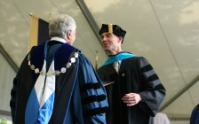 Ryan Ahlenius greets Brenau University President Ed Schrader after Ahlenius received his doctorate in physical therapy during the graduate and undergraduate commencement Saturday May 5, 2018 in Gainesville, Ga. (Jason Getz for Brenau University)