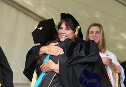 Brenau University Chair of the Physical Therapy Department Kathye Light hugs Amy Tice as she receives her doctorate in physical therapy during the graduate and undergraduate commencement Saturday May 5, 2018 in Gainesville, Ga. (Jason Getz for Brenau University)