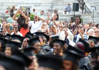 The friends and family members of Daja Jones reacts as he name is announced during the graduate and undergraduate commencement Saturday May 5, 2018 in Gainesville, Ga. (Jason Getz for Brenau University)
