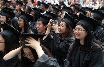 "ANU-Brenau University student Xiangqian ""Cathy"" Wu takes a photograph during the graduate and undergraduate commencement Saturday May 5, 2018 in Gainesville, Ga. (Jason Getz for Brenau University)"