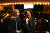 Brenau University students Sara Higgins, left, and Ivie Hall get ready for the graduate and undergraduate commencement Saturday May 5, 2018 in Gainesville, Ga. (Jason Getz for Brenau University)
