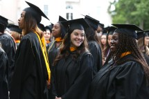 Brenau University students Savannah Martin, left, and Leandra Prempeh talk during the graduate and undergraduate commencement Saturday May 5, 2018 in Gainesville, Ga. (Jason Getz for Brenau University)