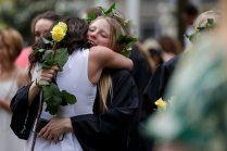 Mason Garland gets a hug during Class Day. (AJ Reynolds/Brenau University)