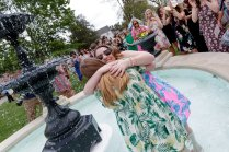 Lauren LaRicci and Amber Stowers in the Grace Hooten Moore Memorial Fountain celebrating their engagements. (AJ Reynolds/Brenau University)