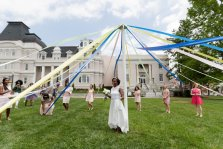 Members of the May Court prepare to wrap the Maypole around May Queen Simone Lewis. (AJ Reynolds/Brenau University)