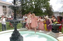 Connie Oldmixon is placed into the fountain during the May Day Celebration of the Alumnae Reunion Weekend & May Day at Brenau University Saturday, April 14, 2018, in Gainesville, Ga. Photo by Jason Getz / Brenau University