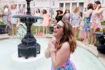 Lauren LaRicci reacts as her Phi Mu sisters throw her into the Grace Hooten Moore Memorial Fountain in celebration of her engagement. (AJ Reynolds/Brenau University)