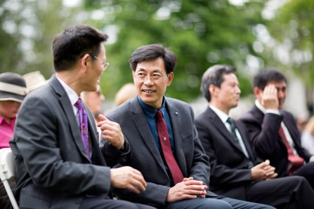Jinze Zheng (left), director of the project department for Anhui Normal University, speaks with Qingsong Sang, dean of the School of Education, during the 2018 Spring Commencement Ceremony on Saturday, May 5, at Brenau University. (Nick Bowman for Brenau University)