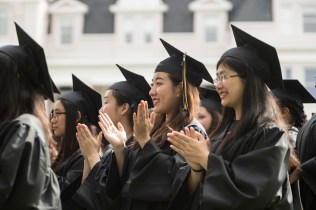Members of the first cohort of the 2+2 partnership between Anhui Normal University and Brenau University smile and applaud during the 2018 Spring Commencement Ceremony on Saturday, May 5, on Brenau University's historic Gainesville campus. (Nick Bowman for Brenau University)