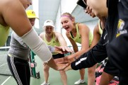 Brenau tennis players, led by seniors Kirsten Dickins and Rebecca Pijls cheer before the start of their conference championship match against SCAD Atlanta. (AJ Reynolds/Brenau University)
