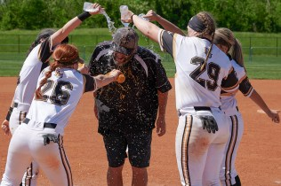 Softball players douse head coach head coach Devon Thomas with water after defeating Milligan College 6-5 in the AAC championship game April 27, in Kingsport, Tenn. (Todd Brase/For Brenau University)