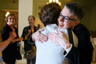 Anne Skleder hugs Shay Stafford.