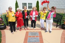 From left, Jane Stoner, Eunice Currie Healy, Diane Railey Curington, Kayanne Massey, Sally Higgins and Glo Kavakos Aaron react as they cut the ribbon for the Chi Omega Terrace dedication.