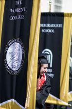 Sommer Stockton hold the Women's College banner