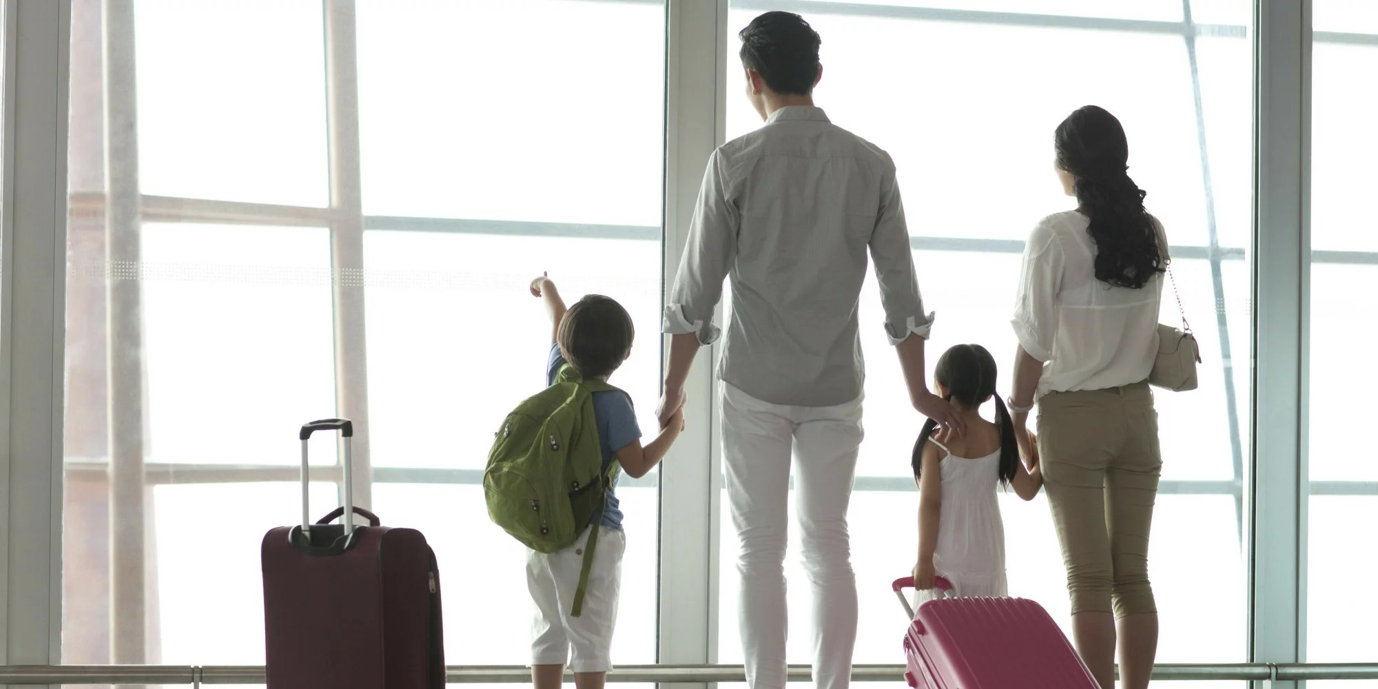 Young family looking at view at the airport