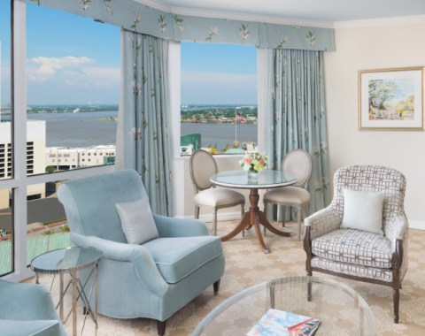 A Premium Suite featuring elegant furniture and views of the Mississippi River from the window