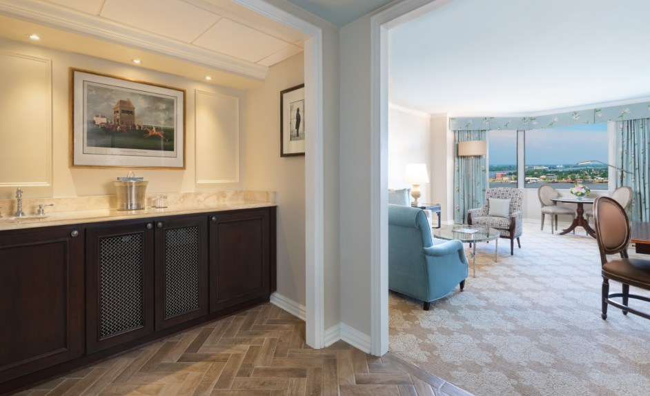 A Premium Club Level Suite with luxury bathroom with Italian marble, elegant furniture, and view of the Mississippi River